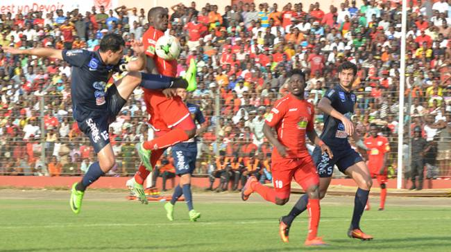 Esperance Captain Khalil Chammam vying for the ball with Horoya's Yacouba Mando in a previous HAC - EST encounter in CAF Champions League. Photo | horoyaac.com