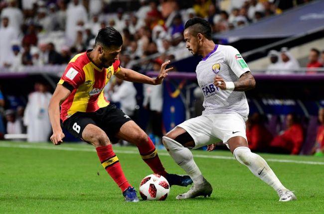 Esperance's Badri vying for the ball with Al Aïn's Caio at FIFA Club World Cup UAE 2018. Photo | Al Ain FC