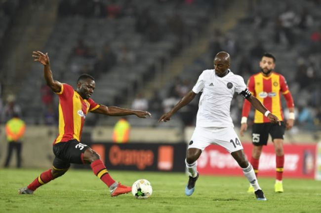 Franck Kom in a fierce duel with Musa Nyatama. Photo | Lefty Shivambu | Gallo Images