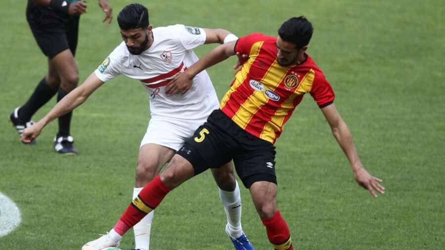 Mohamed Ali Ben Romdhane vying for the ball with Ferjani Sassi. Photo | CAF Online
